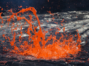 An exploding gas bubble at the lava lake of Erta Ale in Ethiopia (c) Tobias Schorr