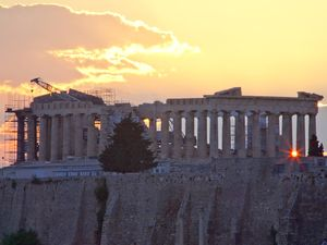 Sunset behind the Parthenon temple of the Acropolis