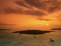 Sunset over the youngest volcano of Greece, the island Nea Kameni